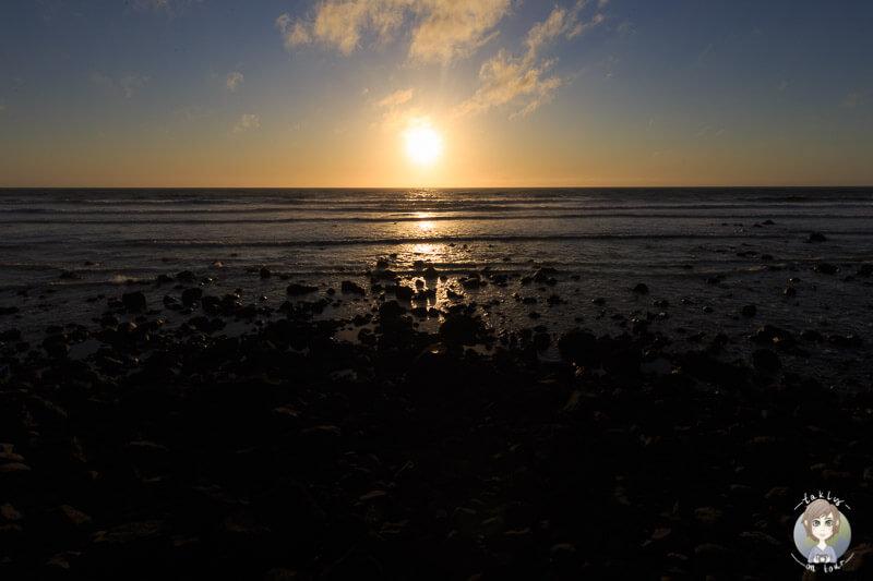 Sonnenuntergang am Cape Egmont, Neuseeland