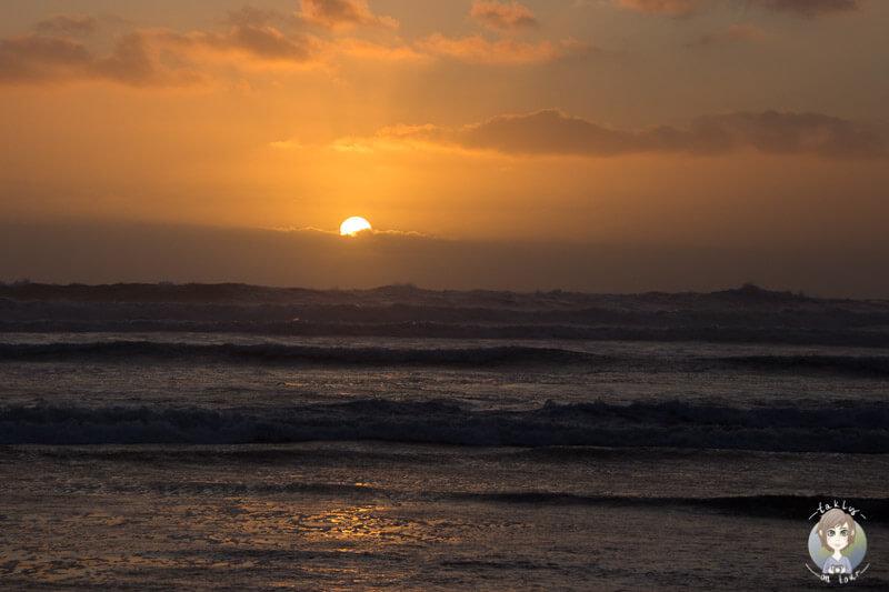 Sonnenuntergang am Muriwai Beach, Neuseeland