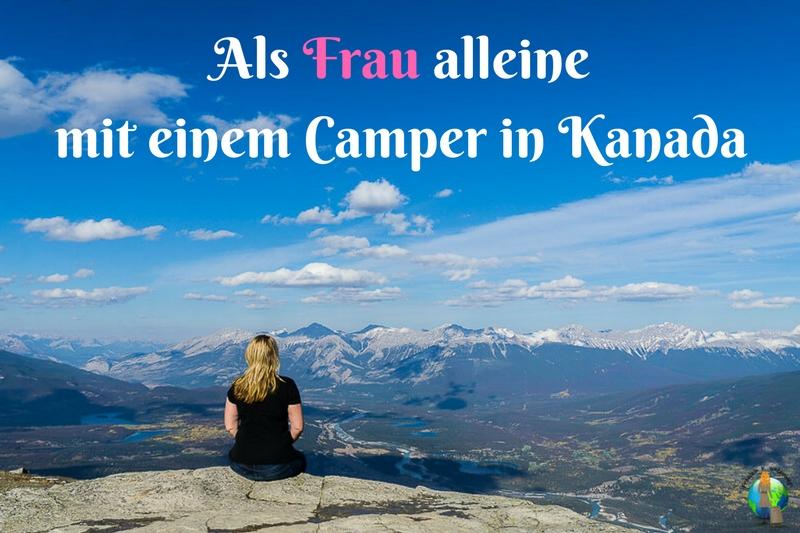 Frau blickt auf die Rocky Mountains Alleine als Frau mit dem Camper in Kanada